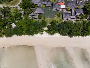Aerial view of Constance Ephelia Resort in Mahé, Seychelles close to the sandy seashore of the Indian Ocean