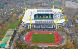 Aerial view of German BVB Stadium Signal Iduna Park and outdoor sports field in Dortmund