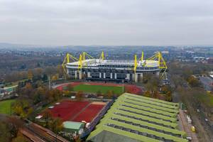 Aerial view of German football stadium Signal Iduna Park, outdoor soccer pitch and running track in Dortmund