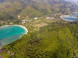 Aerial view of Mahé with the Constance Ephelia Resort Hotel and mangrove forest of Morne Seychelles National Park