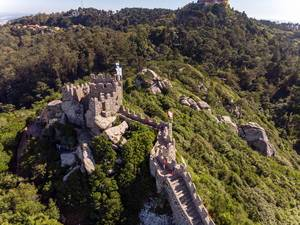 Aerial view of medieval tower of Castelo Dos Mouros with vegetation