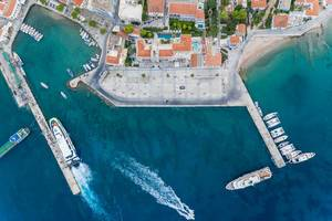 Aerial view of ships on a jetty and a water taxi stand in the blue sea