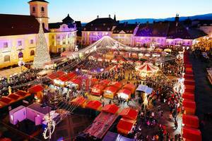 Aerial view of Sibiu Christmas market with Christmas tree and Carousel (Flip 2019)
