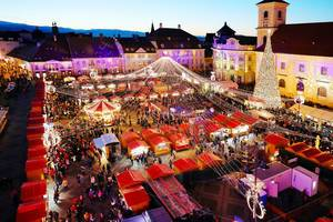 Aerial view of Sibiu Christmas market with Christmas tree and Carousel