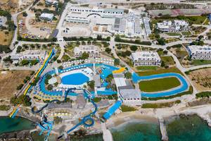 Aerial view of the Aqua Paros water park in Naoussa, Greece, With water slides into the Mediterranean Sea