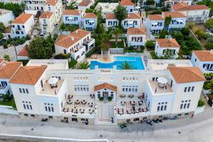 Aerial view of the imposing facade of the greek Hotel Nissia Traditional Residences, with a private Pool, near Dapia on Spetses