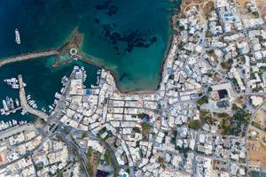 Aerial view of the port city Naoussa, in the northern part of the island Paros, with the remnants of a Venetian castle in the Mediterranean Sea