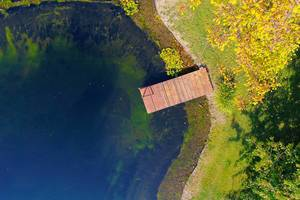Aerial view of wooden pontoon by the lake