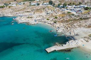 Aerial view shows the rocky coast of granite stones, at Kolimbithres beach, touristic sight on Paros, Greece