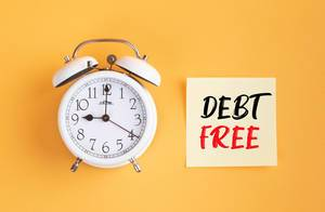 Alarm clock with handwritten text Debt Free