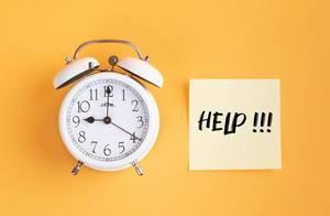 Alarm clock with handwritten text Help