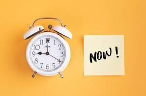 Alarm clock with handwritten text Now!