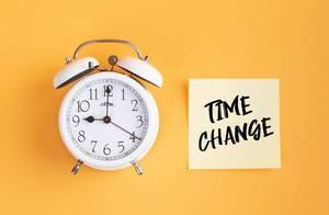 Alarm clock with handwritten text Tax Change