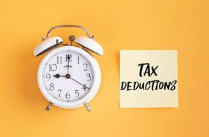 Alarm clock with handwritten text Tax Deductions