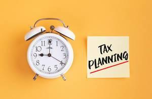 Alarm clock with handwritten text Tax Planning