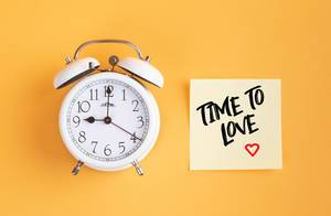 Alarm clock with handwritten text Time to Love
