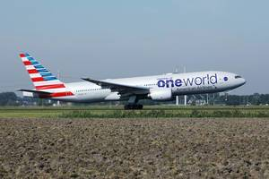 American Airlines, One World livery taking off from Amsterdam Airport AMS
