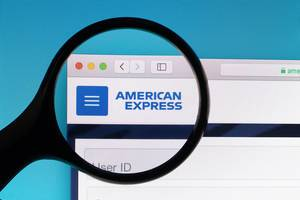 American Express logo under magnifying glass