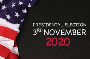 American flag with President election date against a blackboard background