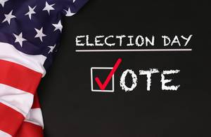 American flag with the text Election day against a blackboard background.jpg