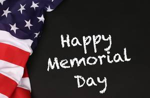 American flag with the text Happy Memorial Day against a blackboard background.jpg