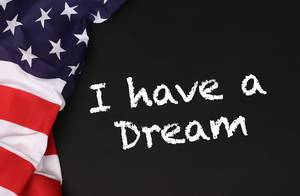 American flag with the text I have a Dream against a blackboard background.jpg