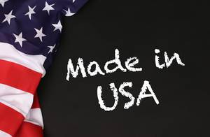 American flag with the text Made in USA against a blackboard background.jpg