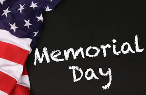 American flag with the text Memorial Day against a blackboard background.jpg