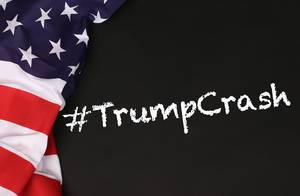 American flag with the text #TrumpCrash against a blackboard background