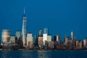 American skyscraper at night on the coast of New York