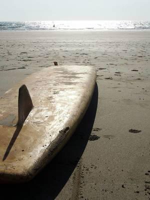 An abandoed surfboard on the beach of Goa, India