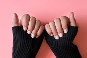 An unrecognizable female showing her hands with beautiful nail manicure.jpg