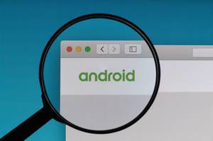 Android logo under magnifying glass