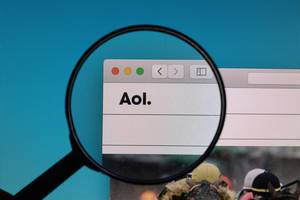 AOL logo under magnifying glass