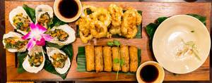 Apetizers in Vietnam: Spring Rolls and Oysters