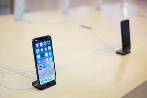 Apple iPhone X on a docking station in an apple store