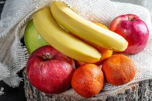 Apples, bananas, tangerines and oranges on burlap (Flip 2019)