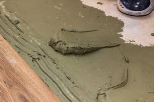 Application of adhesive solution for tile on the floor
