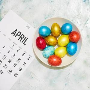 April calendar and a plate of Easter eggs.jpg