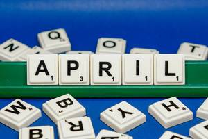 April text on blue background close up shot