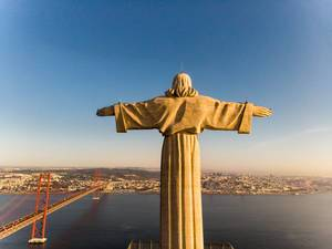 Areal view / drone shot of the Cristo rei monument from behind in Almada Lisbon