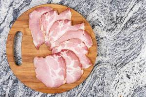 Arranged Pork Dried Neck Meat on the wooden board