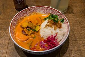 Asian food by at coa Restaurant: Red Hot Chili Curry with beef, sweet potatoes, zucchini, red cabbage, fried onions, carrots and jasmine rice