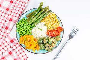 Asparagus, Brussels sprouts, corn, peppers, peas, tomato and rice, top view