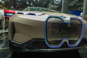 Assistend and highly autonomous driving with cameras and sensors behind kidney-shaped illuminated grilles of BMW Vision iNext