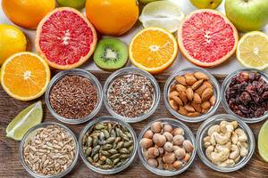 Assortment of colorful fresh fruits, nuts and seeds. Top view (Flip 2019)