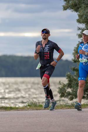 Athlete runs successfully the last meters of the half marathon before finishing the Ironman 70.3 in Lathi, Finland