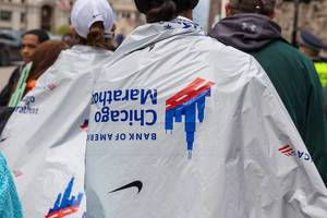 Athletes wrapped in tin foil / heat sheets after finishing Chicago Marathon race