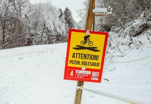 Attention sign at Bike park Pohorje in winter
