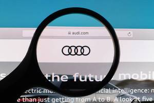 Audi logo under magnifying glass